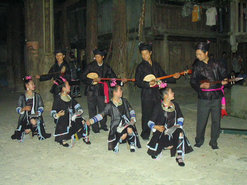 Many locals and a French tour group watch with delight as Dong traditional song and dance is performed.