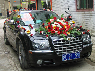 Andy knows some locals.  We travel with one of them to the small town of Huangping to go to her cousin's bridal wedding reception.  This s only for the bride's family and takes place the day before the actual wedding.