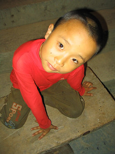 Zhaoxing village kid at the nightly cultural song and dance show.