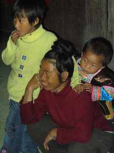 A grandmother and flock happily watch the show.  The grandmother encourages the children to sing along; to learn the songs of their heritage.