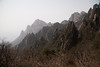 """The absolute classic pictures from Huang Shan involve early morning """"cloud seas"""" where there is an undercast spilling over the ridges and valleys. We weren't quite that lucky, but the visibility was ok, with the ranges of jagged ridges fading into the haze."""