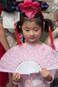 Chinese young girl with pink fan.