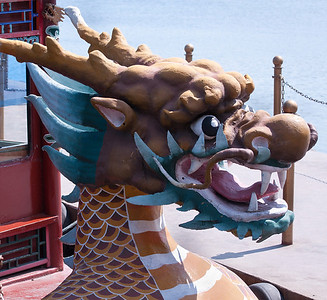 At the Emporer's Summer Palace, a colorful dragon's head can be seen on a sightseeing excursion boat.