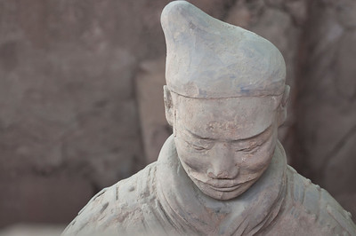 Every statue in the Terra Cotta Army was unique with a different face, expression, and clay sculpted clothing.  Their hats depicted what their role in the Army was.