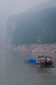 Mountains climbing higher in the mist along the Yangtze River and the Three Gorges.
