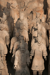 Terra Cotta Army in Pit 1 of the World Heritage Museum in Xian, China.  Buried with the Emperor Qin Shi Huang more than 2,000 years ago.