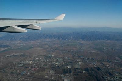 Flight from Beijing, China to Bangkok, Thailand onwards to Mumbai, India.