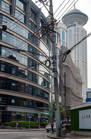 Power lines and skyscraper.