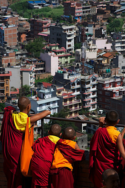 Small little monks looking out over Kathmandu city in Nepal.