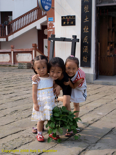 Kids posing in Old Village near arches. Longchang, Sichuan Province, P. R. China. China Trip 30 Aug to 07 Sep 2008.