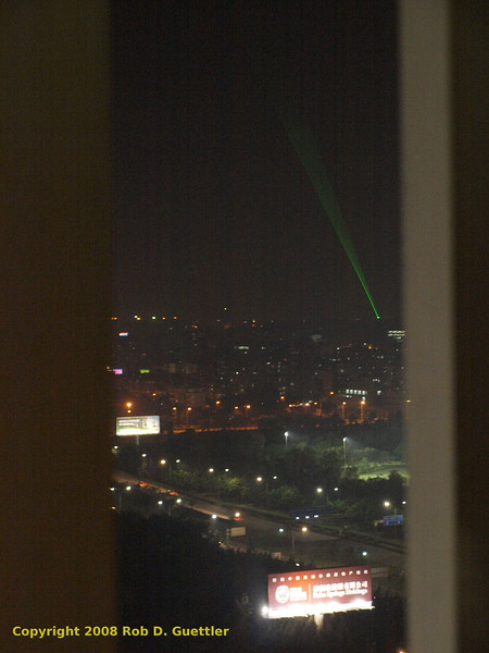 Night time green laser over city from Jinhui hotel. Shenzhen, Guangdong Province, P. R. China. China Trip 30 Aug to 07 Sep 2008.
