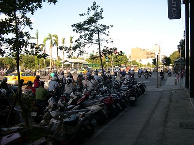 Lane splitting in Taipei - the scooters queue at the front of the pack at every light and leave like a swarm of angry bees.