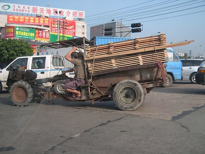 A Chinese 'John Deere'  Basically, a rototiller with an attached wagon.