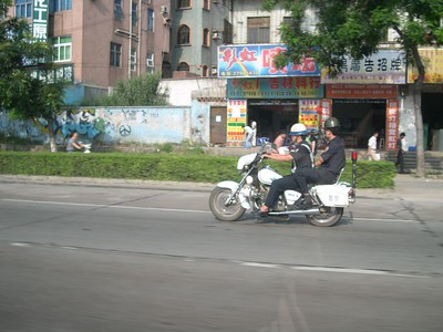 CHiPs Jr. - The Chinese Highway Patrol.  I think that they get 175cc's so that they can run down the offending scooters and cycles.  After the driver dumps his partner off the back....