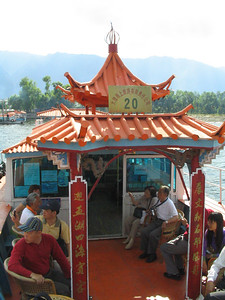 Tourist boat from infamous Erhai Hu boat ride to the unwanted temple.