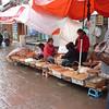 In Fenghuang (Phoenix town). Ladies selling dried shrimp, fish, etc.