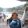 Fenghuang (Phoenix town).  Po Yee in front of the river bordered by houses on stilt.