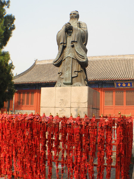 Prayer tablets are left at Confucius' statue.