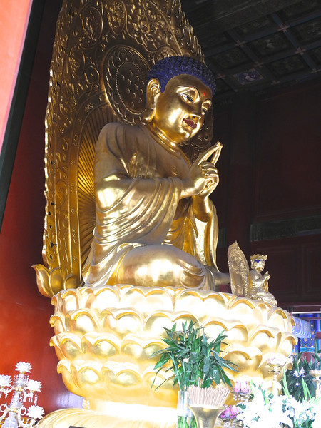 The temple houses a golden Buddha