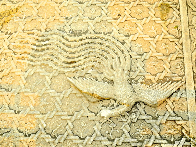 Part of a staircase divider showing a phoenix