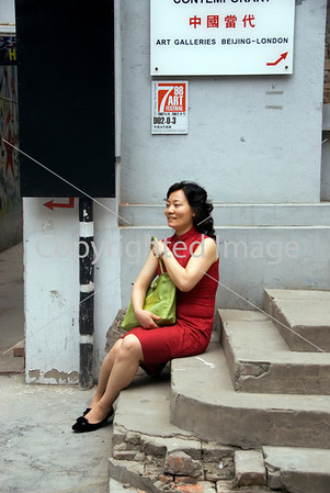 Beijing, CHINA-  Chinese Contemporary Art on Display in Art District 798 in Chaoyang Disrtict, Elegantly-Dressed Woman Waiting Outside Art Gallery Directphoto