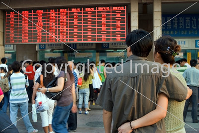 Beijing, CHINA- Beijing Railway Station, People Consulting Timeschedules in Front. Directphoto
