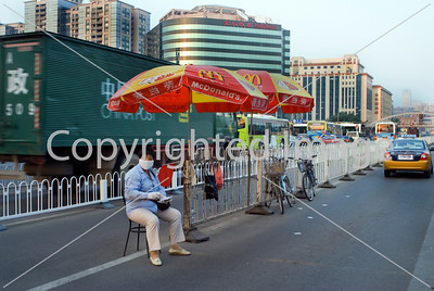 Beijing, CHINA- Beijing Railway Station, Woman Collecting Parking Fees on Street in Front of Station Directphoto