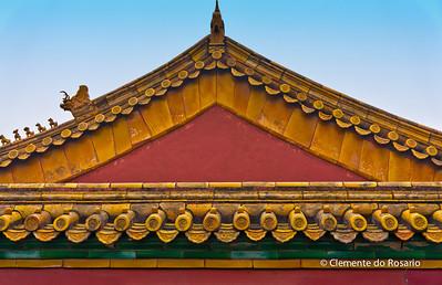 A closeup of a roofline of a building in Forbidden City, Beijing