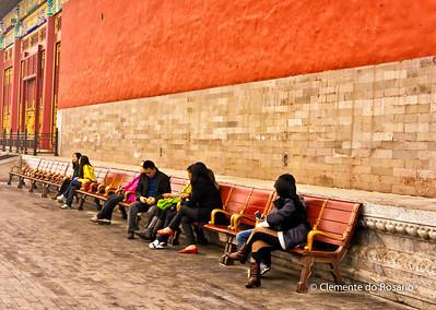 Tourist taking a rest in the Forbidden City, Beijing