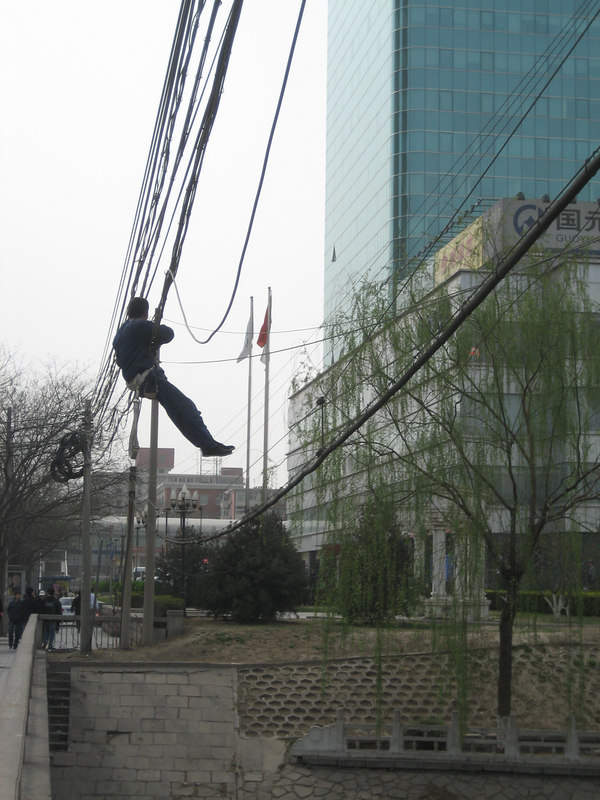 Fixing the electric wires in Beijing
