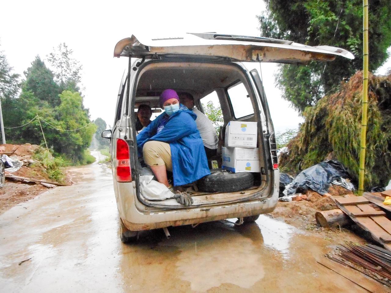 shelter from the rain in the brickmason's  van