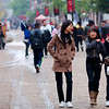 Three students stroll down the street.