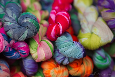 Colorful fabric knotted up for convenience in a boutique.