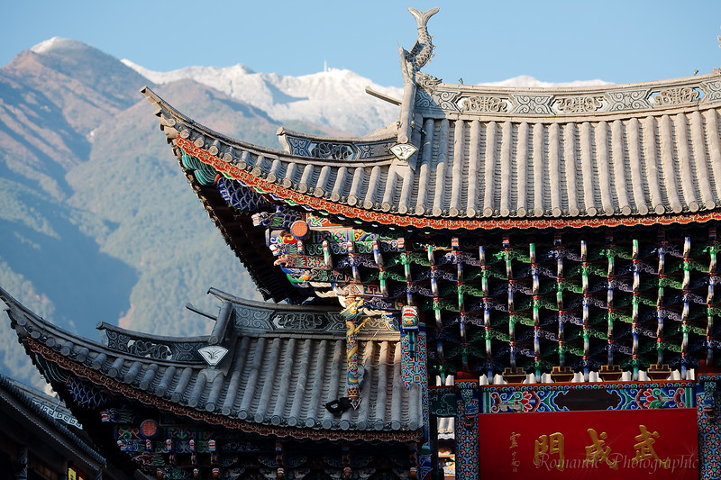 Details of one of the gates, showing the distant Cangshan Mountains.