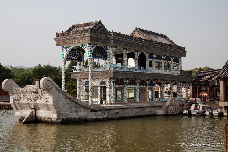China-1481<br /> The Marble Boat was built in 1755. In Ancient China smaller versions of boats would be built as decorations in Gardens. This decoration is built from Marble imitating boats of Emperor Qianlong of the Qing Dynasty. In 1860 the wood portions of the boat burned and Empress Cixi rebuilt it in 1893 with funds embezzled from the Navy.