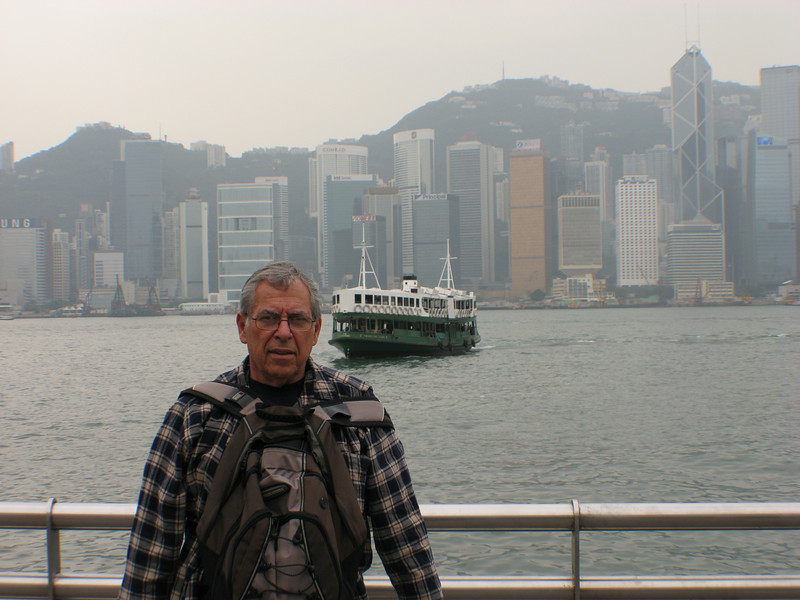 Bob standing in front harbor with view of Hong Kong Island and the Star Ferry