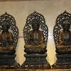 Three Buddhas on wall at Yucca Hotel