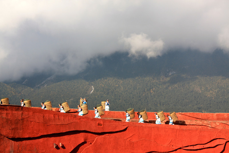 Impressions of Lijiang show with Jade Dragon Snow Mountain hiding in clouds