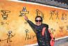 Cindy showing Naxi pictographic script outside Baisha