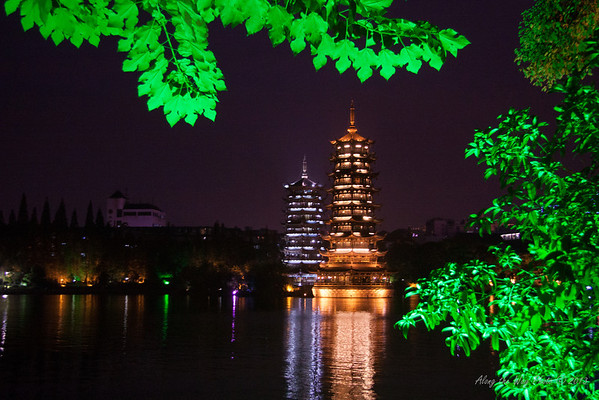 China-2625<br /> Sitting in the middle of Shan Lake in Guilin, are the Twin Pagodas. Sun and Moon Pagodas have become a symbol of Guilin, China. The 7 story Moon Pagoda is connected by a bridge and has an underwater passage connecting the 9 story Sun Pagoda.