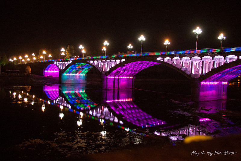 China-3455<br /> The bridges over the river running along Tunxi are lit up at night.