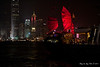 China-3976<br /> At night the buildings are lit up on Hong Kong. There is a Chinese Junk that sails the harbor between Kaloon and Hong Kong.
