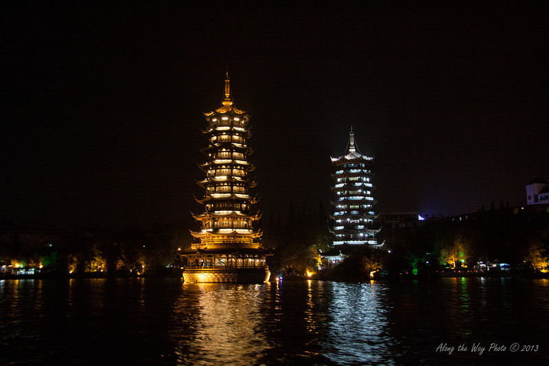 China-2717<br /> Sitting in the middle of Shan Lake in Guilin, are the Twin Pagodas. Sun and Moon Pagodas have become a symbol of Guilin, China. The 7 story Moon Pagoda is connected by a bridge and has an underwater passage connecting the 9 story Sun Pagoda.