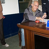 """Me being fingerprinted at the police station to attest to the veracity of my crime report.  Signatures are not a """"thing"""" here, so I had to fingerprint all the salient points of my story (where it happened, when it happened, and what was stolen)."""