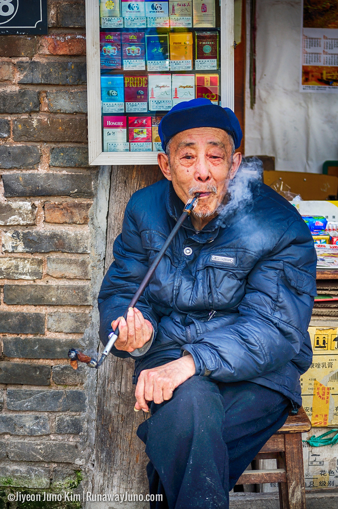 Pingle ancient town - an old man smoking