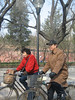 Two bicyclists getting in the way of my planned shot of some old men with bird cages along the east side of Jingshan Park (景山).