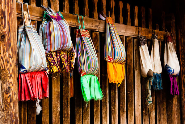 Colorful bags unique to Rebkong hold tsampa and other items for offerings at altars.