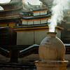 Aromatic smoke from burning tsampa and incense fill the air.