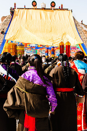 Tibetan Buddhists watch as the thangka, a religious painting or embroidery usually depicting a Buddhist deity. The thangka displayed during Monlam is usually large and only displayed once a year.