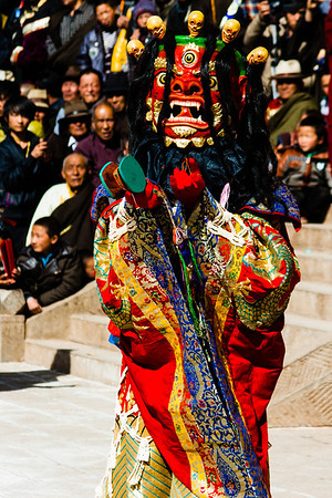 One Palden Lhamo's followers holding a hand drum, which were originally made from two skull cavities covered with stretched skin.
